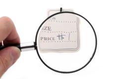 Preis und Vergrößerungsglas stockbild