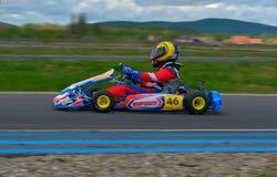 PREJMER, BRASOV, ROEMENIË - MEI 3: Onbekende loodsen die in Nationaal Karting-Kampioenschap Dunlop 2015, op 3 Mei, 2015 in Prejme Royalty-vrije Stock Foto's