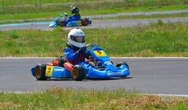 PREJMER, BRASOV, ROEMENIË - MEI 3: Onbekende loodsen die in Nationaal Karting-Kampioenschap Dunlop 2015, op 3 Mei, 2015 in Prejme Royalty-vrije Stock Fotografie
