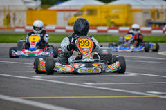 PREJMER, BRASOV, ROMANIA - MAY 3: Unknown pilots competing in National Karting Championship Dunlop 2015, Royalty Free Stock Photos
