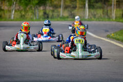 PREJMER, BRASOV, ROMANIA - MAY 3: Unknown pilots competing in National Karting Championship Dunlop 2015,. On May 3, 2015 in Prejmer, Romania Stock Image