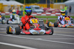 PREJMER, BRASOV, ROMANIA - MAY 3: Unknown pilots competing in National Karting Championship Dunlop 2015,. On May 3, 2015 in Prejmer, Romania Royalty Free Stock Photo