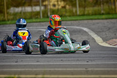 PREJMER, BRASOV, ROMANIA - MAY 3: Unknown pilots competing in National Karting Championship Dunlop 2015 Royalty Free Stock Photos