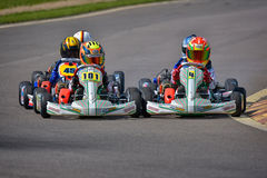 PREJMER, BRASOV, ROMANIA - MAY 3: Unknown pilots competing in National Karting Championship Dunlop 2015,. On May 3, 2015 in Prejmer, Romania Royalty Free Stock Images