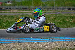 PREJMER, BRASOV, ROMANIA - MAY 3: Unknown pilots competing in National Karting Championship Dunlop 2015, on May 3, 2015 Royalty Free Stock Photos