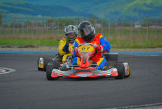 PREJMER, BRASOV, ROMANIA - MAY 3: Unknown pilots competing in National Karting Championship Dunlop 2015, on May 3, 2015 Stock Photography