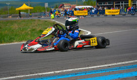 PREJMER, BRASOV, ROMANIA - MAY 3: Unknown pilots competing in National Karting Championship Dunlop 2015, on May 3, 2015 Royalty Free Stock Photography