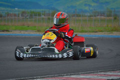 PREJMER, BRASOV, ROMANIA - MAY 3: Unknown pilots competing in National Karting Championship Dunlop 2015, on May 3, 2015 Royalty Free Stock Images