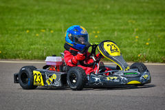 PREJMER, BRASOV, ROMANIA - MAY 3: Unknown pilots competing in National Karting Championship Dunlop 2015, on May 3, 2015 in Prejmer. Romania Royalty Free Stock Photo