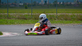 PREJMER, BRASOV, ROMANIA - MAY 3: Unknown pilots competing in National Karting Championship Dunlop 2015, on May 3, 2015 in Prejmer. Brasov, Romania Royalty Free Stock Photography