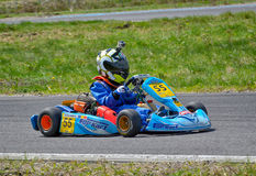 PREJMER, BRASOV, ROMANIA - MAY 3: Unknown pilots competing in National Karting Championship Dunlop 2015, on May 3, 2015 in Prejmer. Brasov, Romania Stock Image