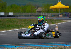 PREJMER, BRASOV, ROMANIA - MAY 3: Unknown pilots competing in National Karting Championship Dunlop 2015, on May 3, 2015 in Prejmer. Brasov, Romania Royalty Free Stock Images