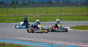 PREJMER, BRASOV, ROMANIA - MAY 3: Unknown pilots competing in National Karting Championship Dunlop 2015, on May 3, 2015 in Prejmer. Brasov, Romania Royalty Free Stock Photo
