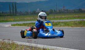 PREJMER, BRASOV, ROMANIA - MAY 3: Unknown pilots competing in National Karting Championship Dunlop 2015, on May 3, 2015 in Prejmer. Brasov, Romania Royalty Free Stock Image