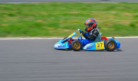PREJMER, BRASOV, ROMANIA - MAY 3: Unknown pilots competing in National Karting Championship Dunlop 2015, on May 3, 2015 in Prejmer. Romania Royalty Free Stock Images