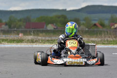 PREJMER, BRASOV, ROMANIA - MAY 3: Unknown pilots competing in National Karting Championship Dunlop 2015, on May 3, 2015 in Prejmer Royalty Free Stock Photo