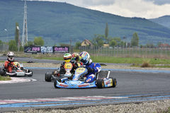 PREJMER, BRASOV, ROMANIA - MAY 3: Unknown pilots competing in National Karting Championship Dunlop 2015, on May 3, 2015 in Prejmer Royalty Free Stock Photography