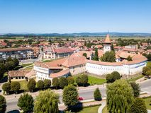 Prejmer Fortified Church, Brasov County, Transylvania, Romania. Aerial view. Medieval fortress with a church, clock tower, high spire, thick walls, red tiled royalty free stock image