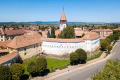 Prejmer Fortified Church, Brasov County, Transylvania, Romania. Aerial view. Medieval fortress with a church, clock tower, high spire, thick walls, red tiled stock photo