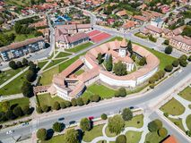 Prejmer Fortified Church, Brasov County, Transylvania, Romania. Aerial view. Medieval fortress with a church, clock tower, high spire, thick walls, red tiled royalty free stock images