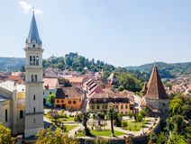 Prejmer Fortified Church, Brasov County, Transylvania, Romania. Aerial view. Medieval fortress with a church, clock tower, high spire, thick walls, red tiled royalty free stock photos