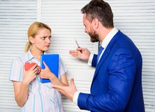 Prejudice and personal attitude to employee. Office quarrel concept. Misunderstanding between colleagues. Tense. Conversation or quarrel between colleagues royalty free stock photos