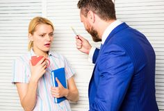 Prejudice and personal attitude to employee. Tense conversation or quarrel between colleagues. Boss discriminate female royalty free stock photos