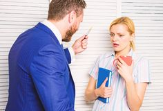 Prejudice and personal attitude to employee. Tense conversation or quarrel between colleagues. Boss discriminate female. Worker. Discrimination and personal stock images