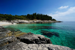 Premantura Pensinsula coast, Croatia. Beach with crystal-clear water in Premantura Peninsula rugged coastline, Croatia stock photos