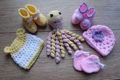 Premature baby items for comfort and warmth. hat and booties royalty free stock photography
