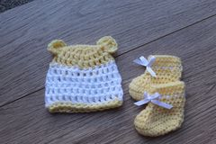 Premature baby items for comfort and warmth. hat and booties stock photos