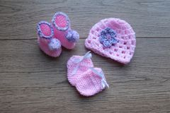 Premature baby items for comfort and warmth. hat and booties royalty free stock photos