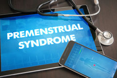 Premenstrual syndrome (menstrual cycle related) medical concept. On tablet screen with stethoscope stock photography