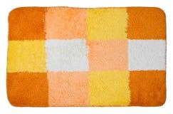 Première vue de tapis de bain coloré d'isolement Photographie stock libre de droits