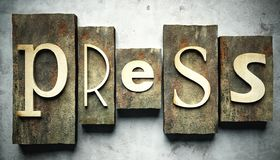 Premi il concetto con scritto tipografico d'annata Immagini Stock