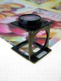 Premi la lente d'ingrandimento 2 Fotografie Stock Libere da Diritti