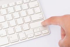 Premi la tastiera. soppressione il dito immagini stock