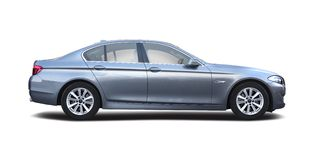 Premia rodzinny samochód odizolowywający na bielu Zdjęcia Royalty Free