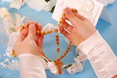 Premier communion-rosaire saint Photographie stock
