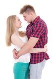 Premier concept d'amour - étreintes de jeune homme et de femme d'isolement sur le blanc Photos stock