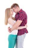 Premier concept d'amour - baisers de jeune homme et de femme d'isolement sur le whi Photos stock