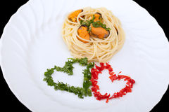 Premier cours d'Italien - spaghetti et moules Photos stock