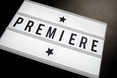 Premiere written on word board in movie theme. A close up of premiere written on word board with stars in a cinema movie theme Stock Photography
