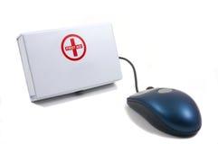 Premiers soins pour des ordinateurs, souris Photographie stock