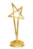 Premio dorato della stella sul basamento con la zolla in bianco Fotografia Stock