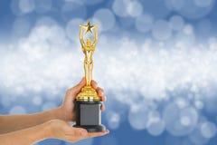 Premios del trofeo después del ganador acertado imagen de archivo