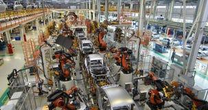 Premisa vaga de la planta de fabricación producción de coches Imagen Defocused de la fábrica del coche almacen de metraje de vídeo