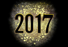 The premise of 2017 black greeting card New Year. Happy New Year 2017 greeting card with numbers on a black background.Merry Christmas Design Gold Dust explosion Royalty Free Stock Photography
