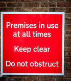Premises in use sign Stock Images