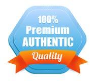 Premium Authentic Quality Badge. Blue 100 percent premium authentic quality badge with an orange ribbon Stock Photos